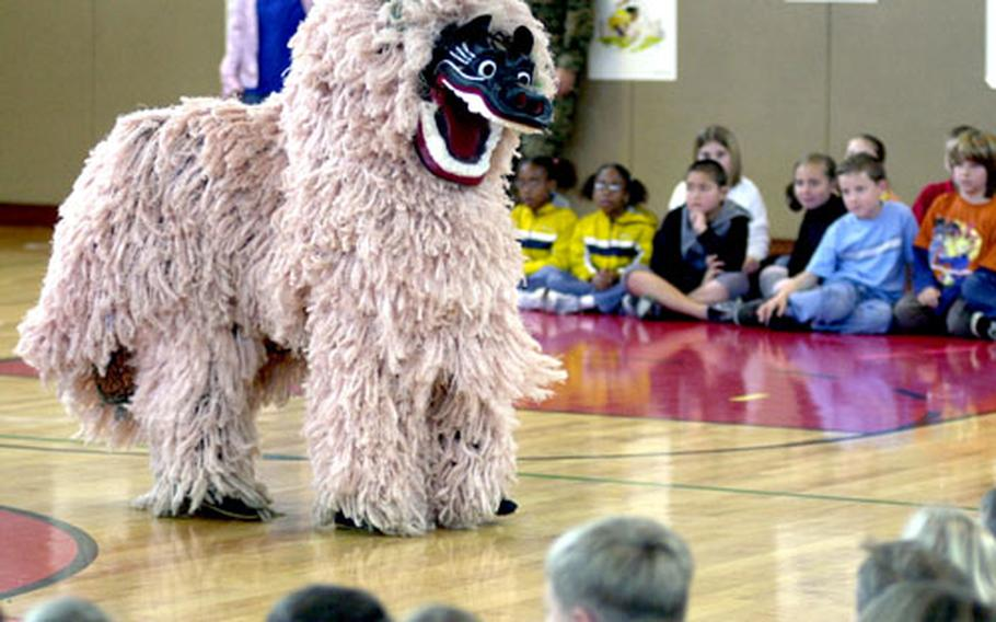 Bechtel Elementary School students are treated to a Shishi lion dance performed by students from the Yomitan Elementary and Junior High Schools Tuesday.