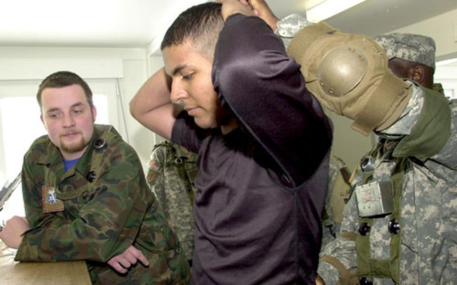German university student Alexander Grellmann, left, role plays as a translator while 1st Battalion, 4th Infantry Regiment soldier Sgt. Arturo Brito, 29, of Bronx, N.Y. role plays as an insurgent at Hohenfels last Monday. Brito met his wife, Elena Friedmann, at the training range. The couple is to be featured in a German television documentary later this year.