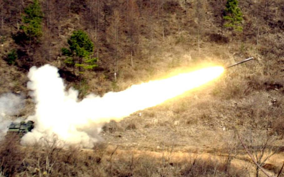 A crew from 2nd Infantry Division's 1st Battalion, 38th Field Artillery, fires a reduced-range rocket inside the remote Boar 1 training area in South Korea on Tuesday.
