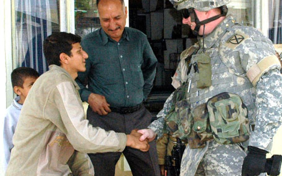 Capt. Mike Fortenberry greets residents after his unit returned here last month to assist Iraqi troops and quell sectarian violence.