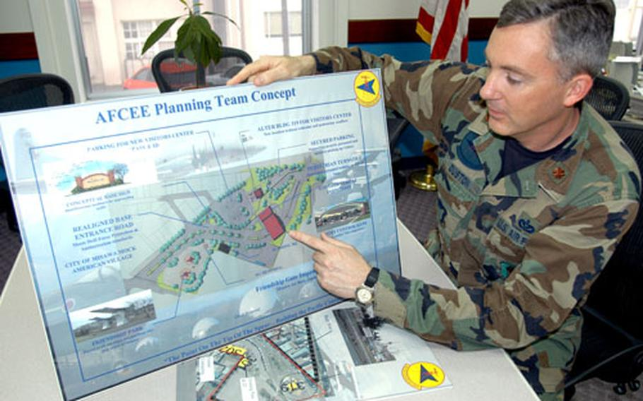 Maj. Mathew Duston, 35th Civil Engineer Squadron Engineering Flight commander, looks at a draft redesign of the area outside Misawa Air Base's main gate. The base is redesigning the area in part to blend better with a new shopping district the city of Misawa hopes to open in 2008.