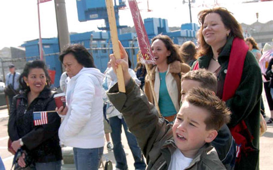 Richard Arnold, 6, waves to his dad aboard the USS Blue Ridge Friday morning at Yokosuka Naval Base.