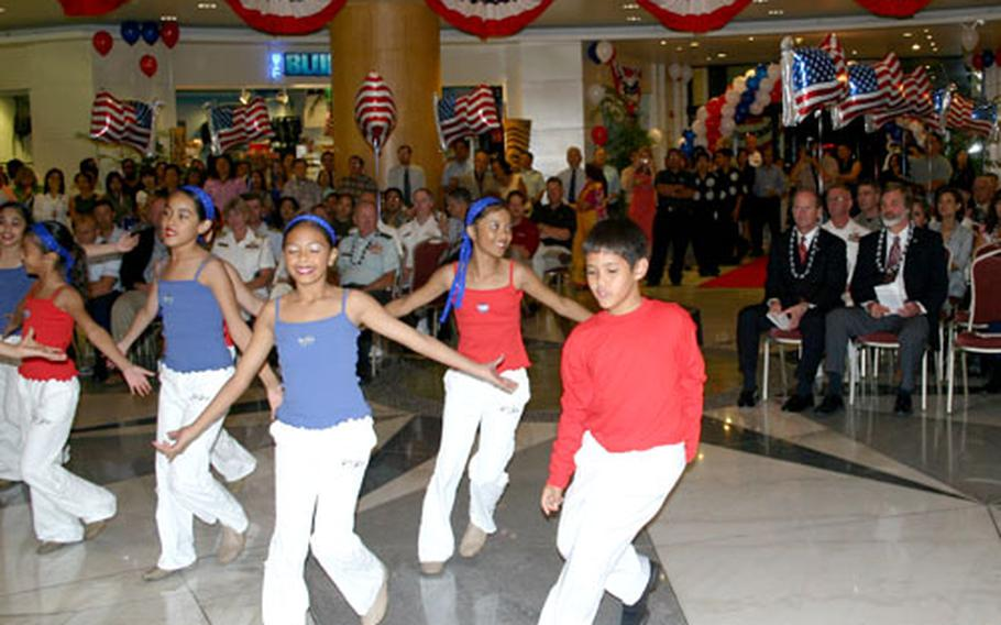 Members of local Guam dance troupe SKIP Entertainment perform during the opening ceremony of the Guam USO location in the Royal Orchid Hotel in Tumon, Guam.