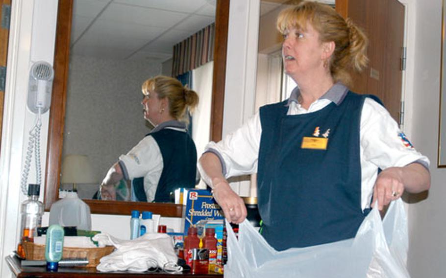 Kim Roche cleans a room at the RAF Lakenheath Air Force Inn.