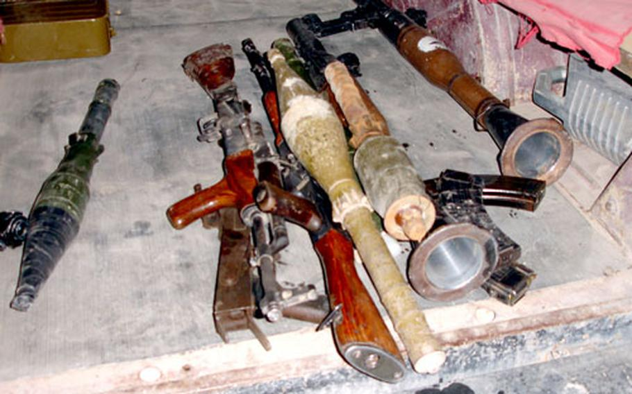 Many weapons were uncovered during the operation, including two rocket-propelled grenade launchers, three AK-47s, and one ammunition can with heavy machine-gun rounds.