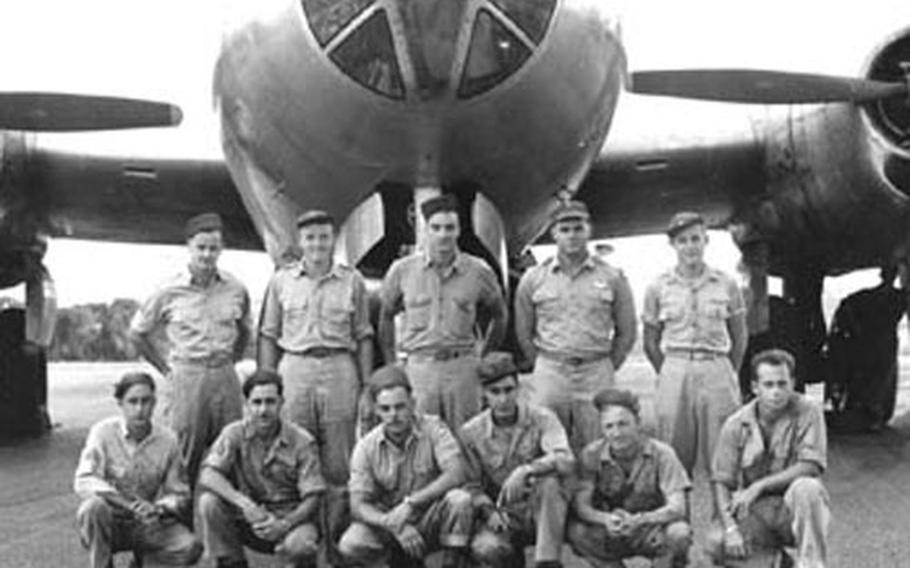 An undated photo of 11 U.S. aircrew members from a B-29 that crashed April 2, 1945, into a mountain at Yugimachi in Ome City, Japan, during World War II. Five American servicemembers were killed while six others parachuted to safety but were taken prisoner of war.