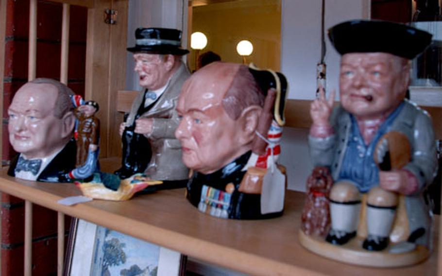 Winston Churchill figurines are among the many items for sale at the Newmarket Racecourse antique fair.