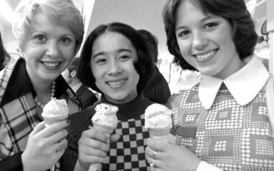 Standout figure skaters Karen Magnussen of Canada, Cathy Watanabe of Japan and Dorothy Hamill of the U.S., left to right, take an ice cream break.