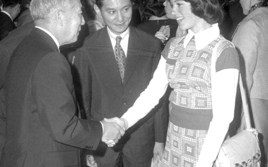 Dorothy Hamill meets Japan's Prince Takada.