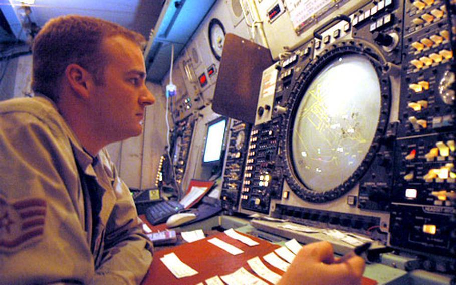 Air Force Staff Sgt. Scott Williams, 27, of Oklahoma City, Okla., monitors air traffic on a radar screen at Ali Base Monday.