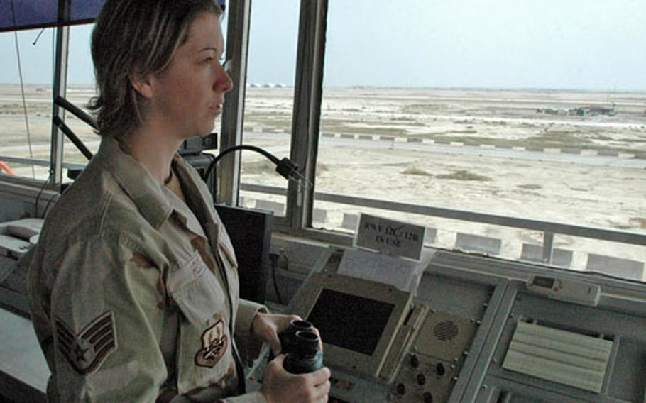Air Force Staff Sgt. Nichole Heise, from Pender, Neb., monitors traffic Monday at the Ali Base control tower in Iraq. While the radar traffic controllers monitor aircraft in the southern third of Iraqi airspace, control tower personnel direct arriving and departing aircraft at the base. Heise said she also observes sunsets from the tower.