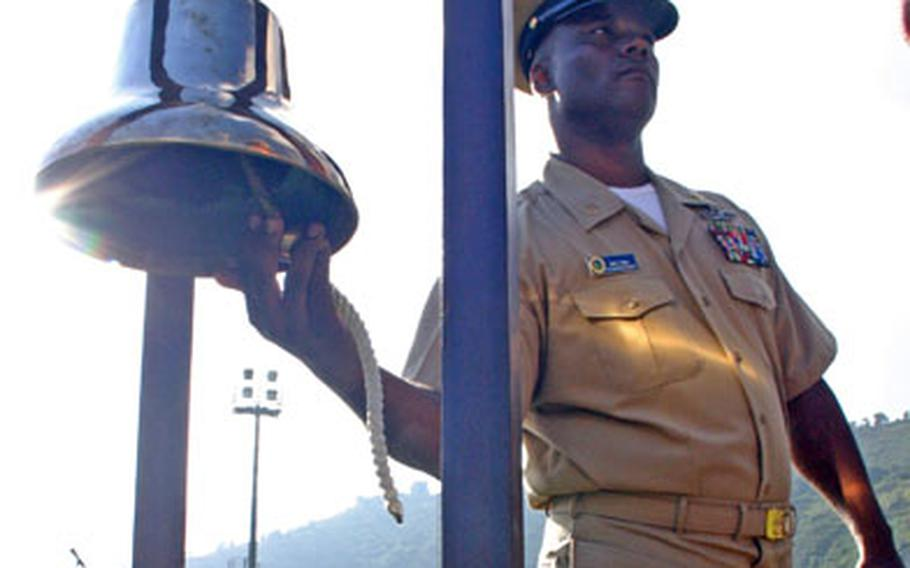 """Chief Petty Officer Aaron Caples rings the """"Chief's Bell"""" last September after being pinned with the coveted golden anchors. The bell-ringing tradition will continue as the Navy prepares to require attendance of a CPO Academy for newly selected chief petty officers."""