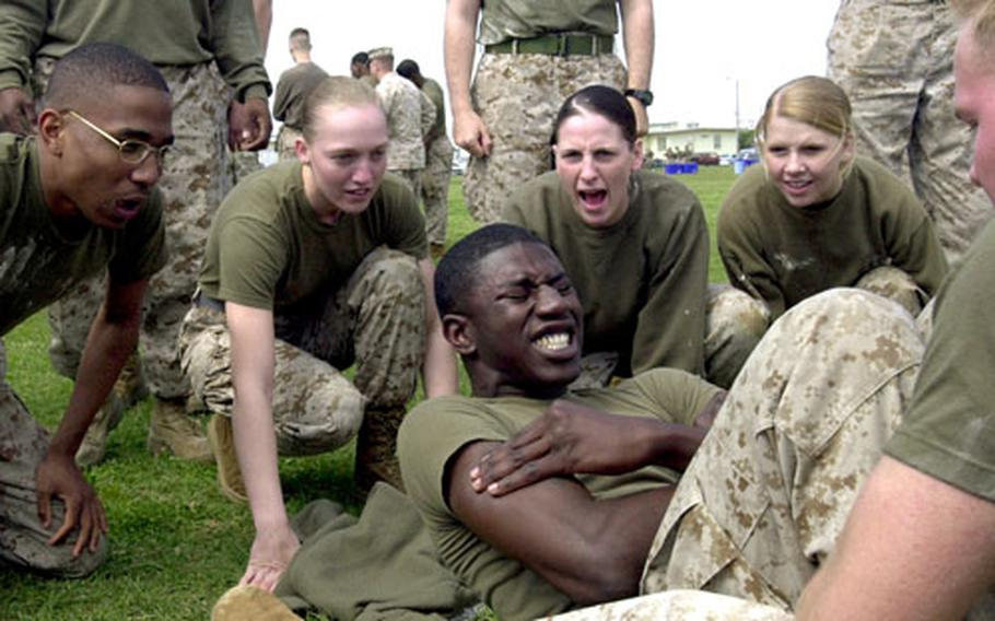 Marines cheer on a teammate during a crunch competition at the field meet.
