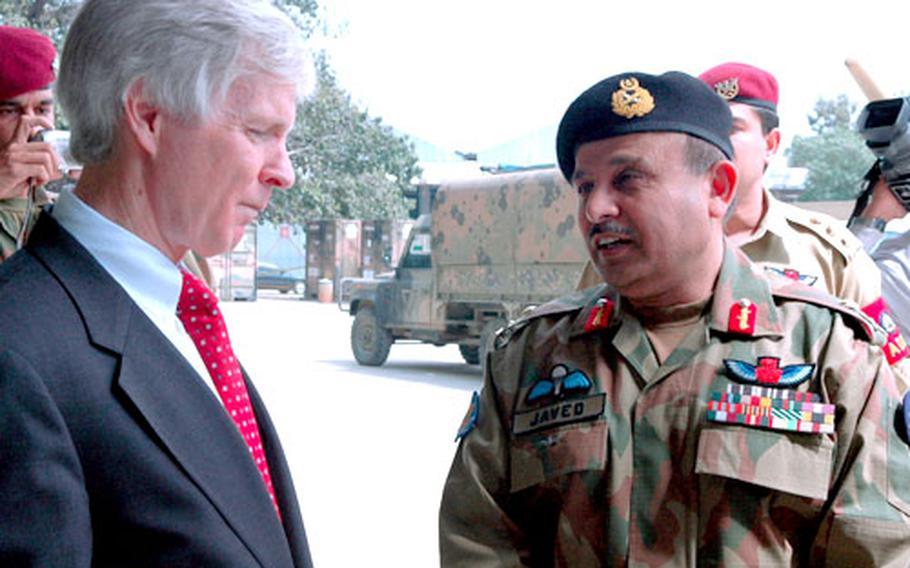 U.S. Ambassador to Pakistan Ryan Crocker with Maj. Gen. Javed Aslam Tahir, commander of Pakistani Army Aviation.