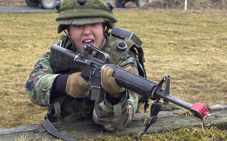 A soldier from the 141st Signal Battalion's Company C fires blanks during convoy training at Grafenwöhr on Thursday. Under a change in Army tactics, soldiers who come under attack while on a convoy, will now stand and fight the enemy instead of shooting and pressing on.