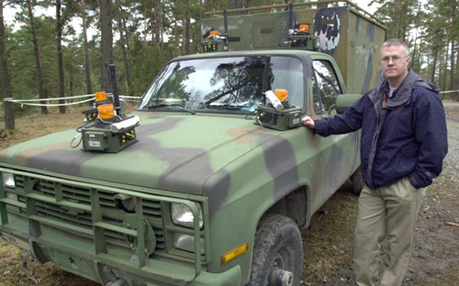 Jim Meredith, section chief of the Training Support Activity Europe's Deployable Instrumentation Systems Europe, Tuesday with a vehicle covered in sensors that can relay data to satellites and allow trainers to watch the vehicle's movements in real-time and record them for after-action review.