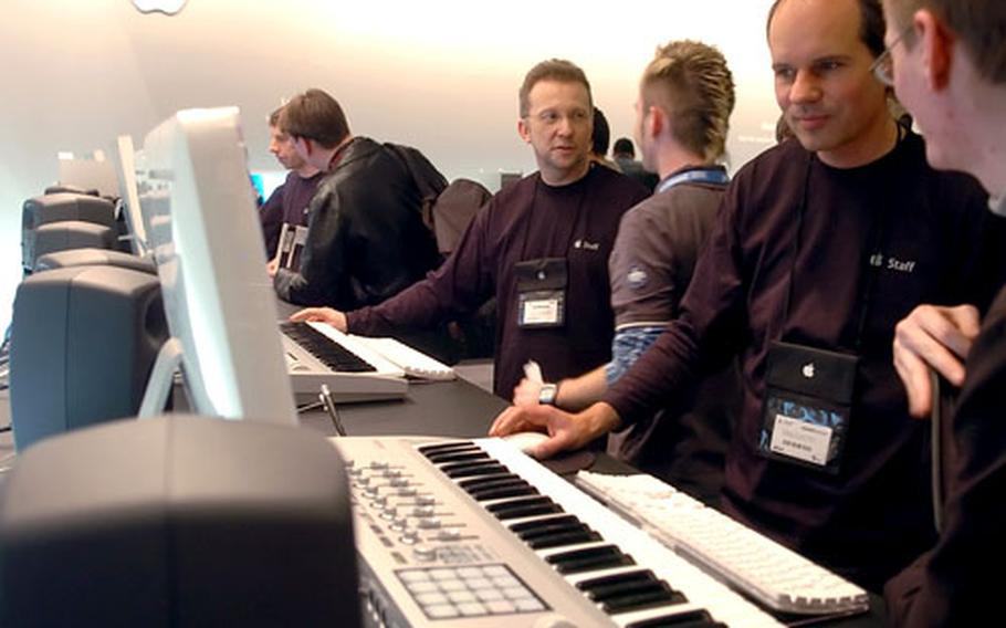 Apple Computer representatives demonstrate their latest offerings in digital recording software technology, GarageBand 3 and Logic Pro 7, at the 2006 Frankfurt Musikmesse on Wednesday.