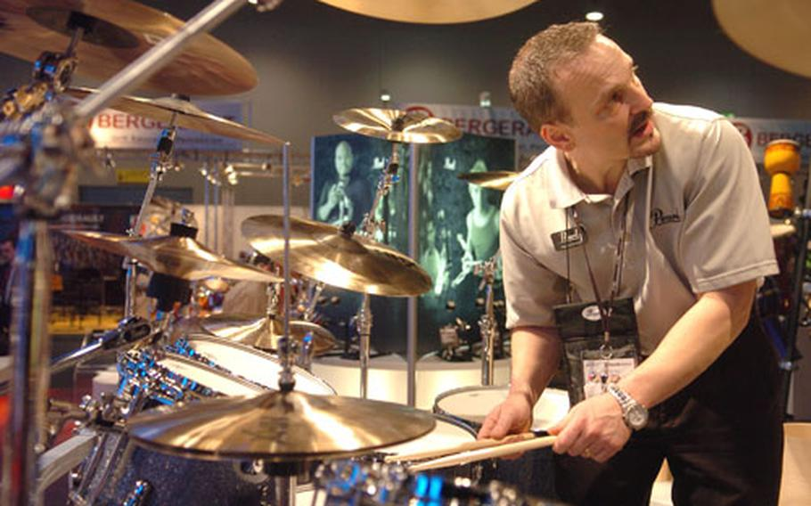 Pearl Drums representative Raymond Massey shows off some of the company's products.