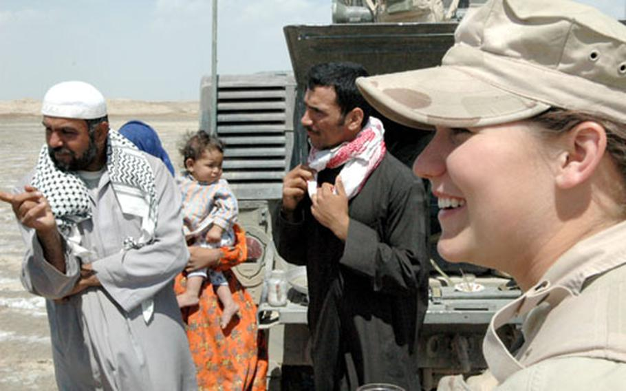 Airman Britney Simpson, 19, of Milan, Tenn., drinks chai during a visit with a Bedouin family near Ali Base.