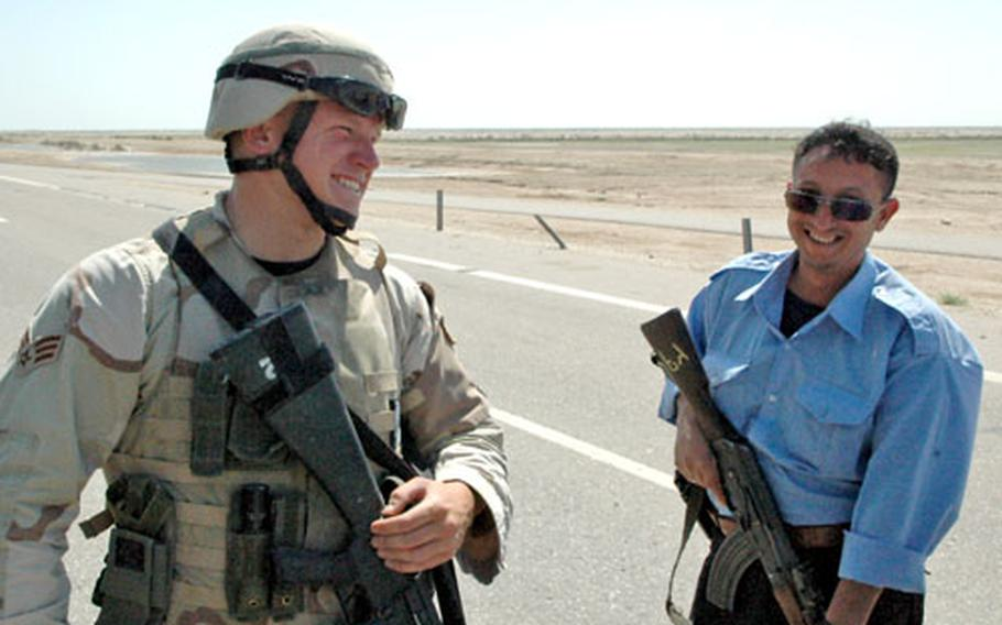 Senior Airman Aaron Giere, 22, of Hawley, Minn., jokes with an Iraqi highway patrolman while providing security for Ali Base in southern Iraq recently.