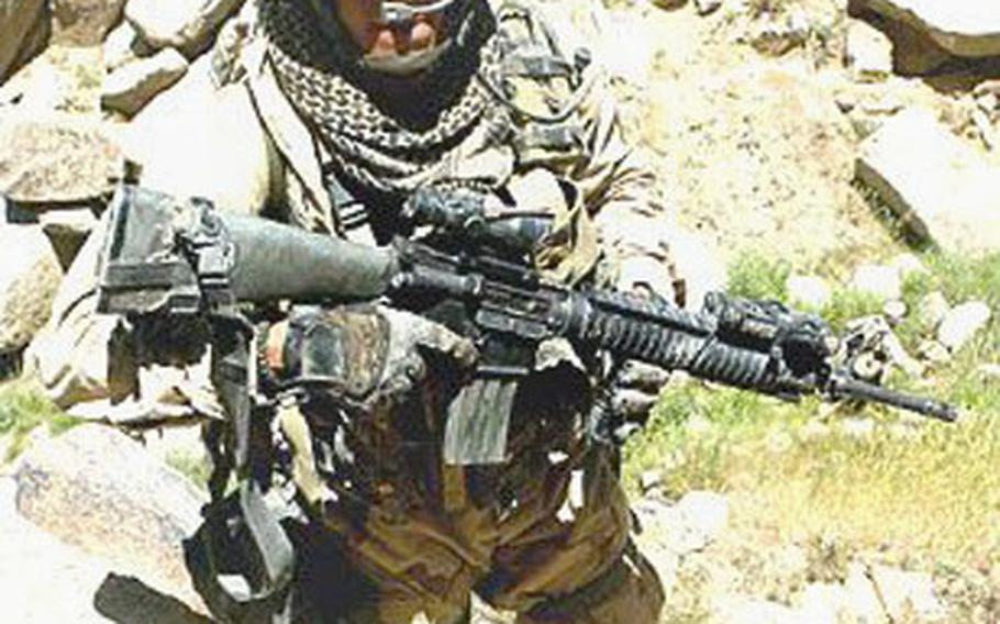 Despite a bullet in the leg, Marine Staff Sgt. Anthony Viggiani continued to lead his squad against the enemy in Afghanistan in 2004.