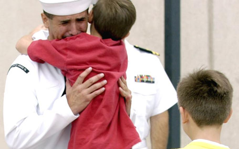 Hospital Corpsman 2nd Class Juan M. Rubio gets a hug from one of his children after he was awarded the Silver Star.