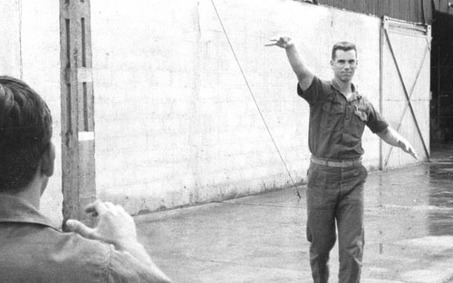 Ensign Roger Staubach tosses a football during a break from his duties at Da Nang in October, 1966.