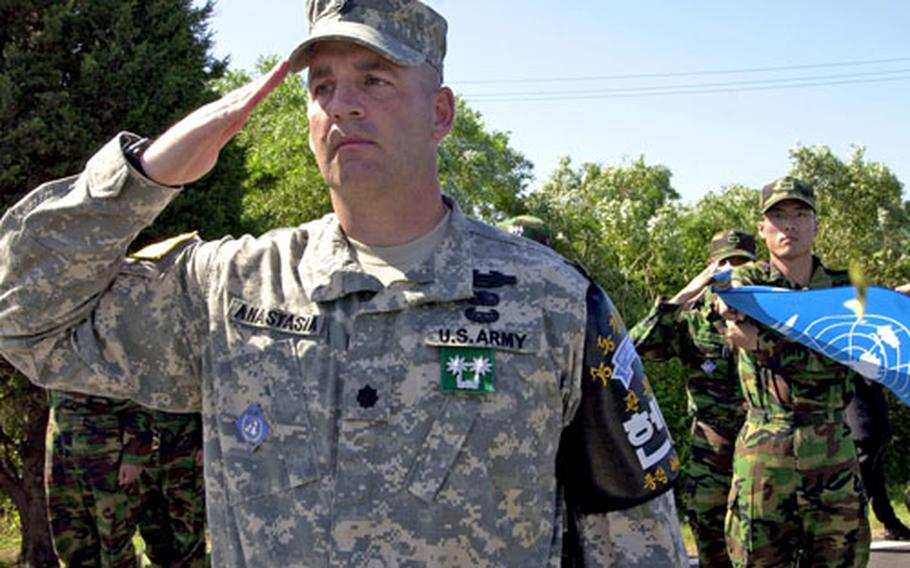 Lt. Col. Michael W. Anastasia, commander of the United Nations Command Security Battalion-Joint Security Area, salutes the memorial for two U.S. soldiers killed in the JSA during an Aug. 18, 1976, attack.