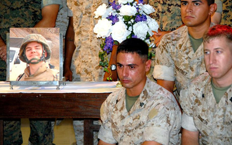 Marines at Camp Hansen on Okinawa hold a memorial service Monday for Sgt. John Phillips, who died after a five-month fight to survive burns suffered in Fallujah, Iraq, in March. During his recovery, Phillips married his girlfriend and was on the mend when infections set in and took his life.
