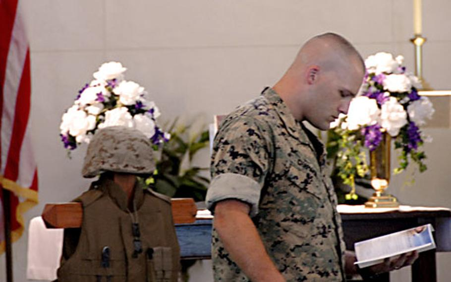 Sgt. Michael Chapman prepares to eulogize his friend and fellow Marine Sgt. John Phillips at a memorial service for Phillips on Monday at Camp Hansen, Okinawa.