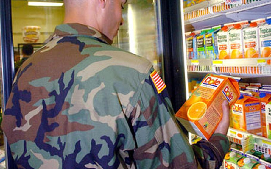 Army Pfc. Juan A. Rivas eyes the juice selection Wednesday at the newly opened commissary on Camp Eagle, South Korea. The commissary is housed in a renovated warehouse and will serve the Camp Eagle and Camp Long communities.