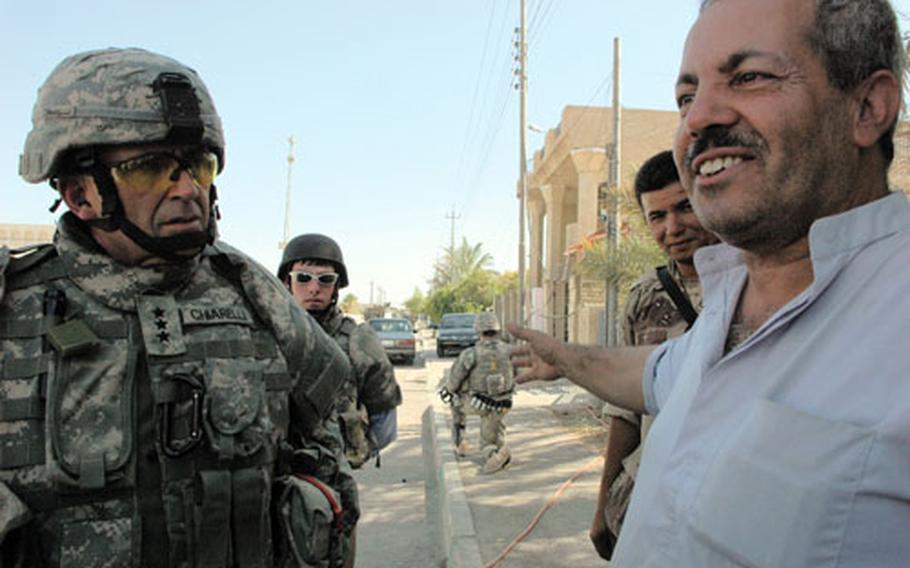 Baghdad resident Abdul Qadr talks Thursday with Lt. Gen. Peter Chiarelli, commander of Multi-National Corps-Iraq.