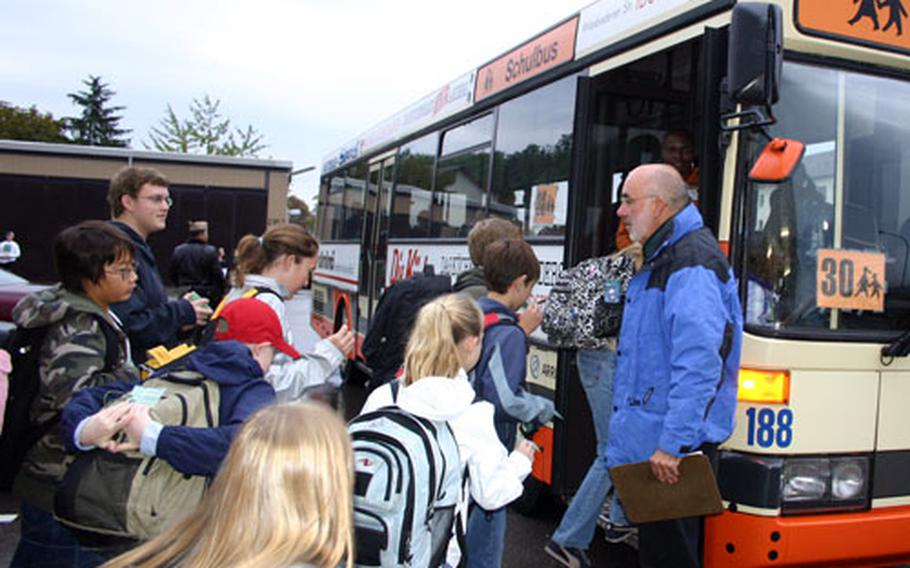Steve DiMundo, a transportation coordinator with Department of Defense Dependents Schools in Stuttgart, Germany, helps middle school students get on the correct buses for the trip from Patch Barracks to Robinson Elementary/Middle School.