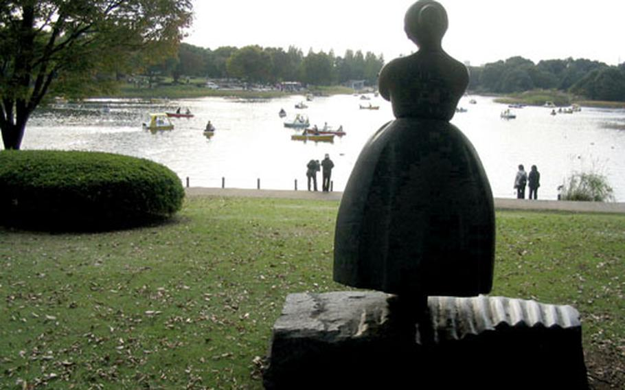 A sculpture looks over a lake crowded with boaters at Showa Kinen Park in Tachikawa, Japan, not far from Yokota Air Base. The park is on land that once was Tachikawa Air Base but was returned to Japan in November 1977.