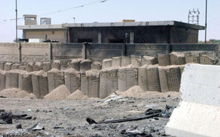 Charred debris surrounds an Iraqi police station north of Ramadi after a recent suicide car bomb attack.