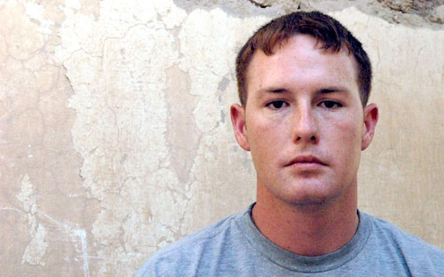 Sgt. Eric Baker, 24, of Wauchula, Fla., suffered second- and third-degree burns to his right arm and burns to the back of his head and neck during a car bomb attack on an Iraqi police station near Ramadi recently.
