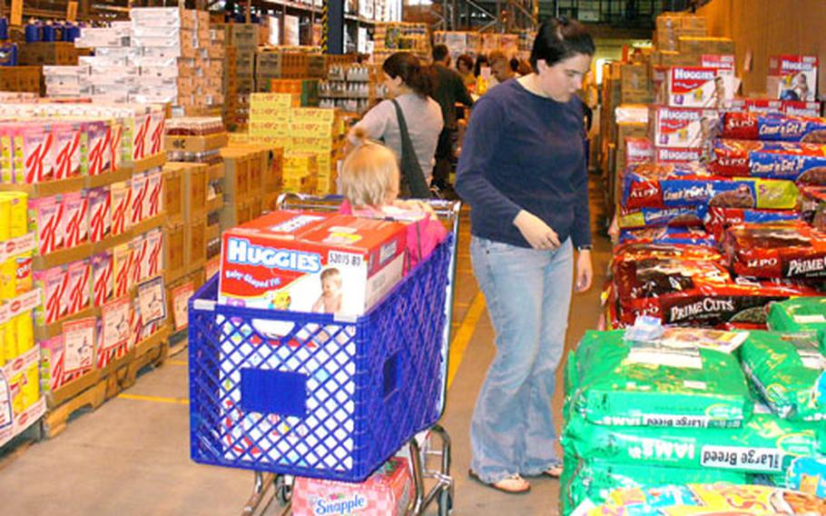 Shoppers at the commissary at RAF Lakenheath, England, take advantage of a case lot sale earlier this year. Customers throughout the Defense Commissary Agency-Europe will again have that opportunity this month when the agency holds its final case lot sale of the year.