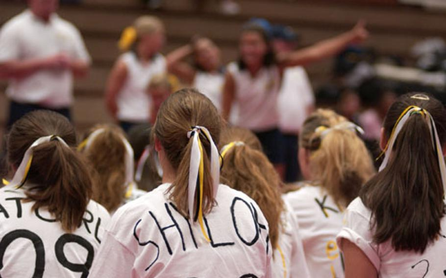 Custom decorated shirts and pony tails in bows were Patch High School's ways of showing team spirit during the first day of cheer camp Friday in Kaiserslautern, Germany.
