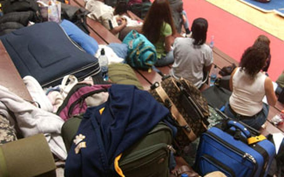 Piles of sleeping bags, pillows and gym bags cover the bleachers during the opening night of cheer camp Friday in Kaiserslautern, Germany. More than 200 cheerleaders camped out on the gym floor at Kaiserslautern High School.