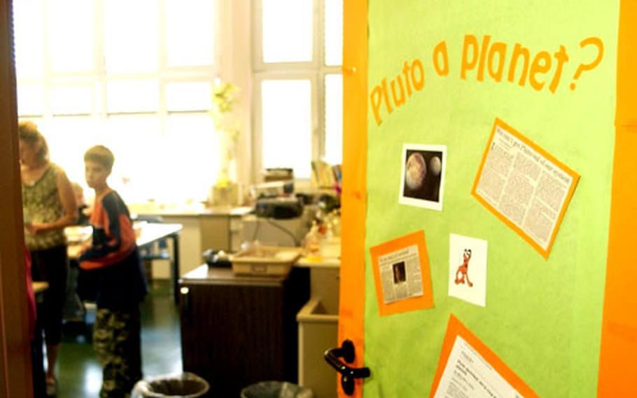 Items related to Pluto's demotion to dwarf planet decorate the door to Elane Edwards' 7th grade classroom.