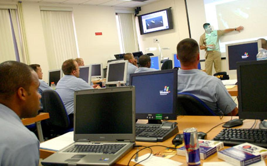 Master Chief Petty Officer Cliff Deason gives a lesson on priorities of the Navy's 6th Fleet to selectees on Aug. 29, the first day of the Chief Petty Officer Academy prototype program in Europe.