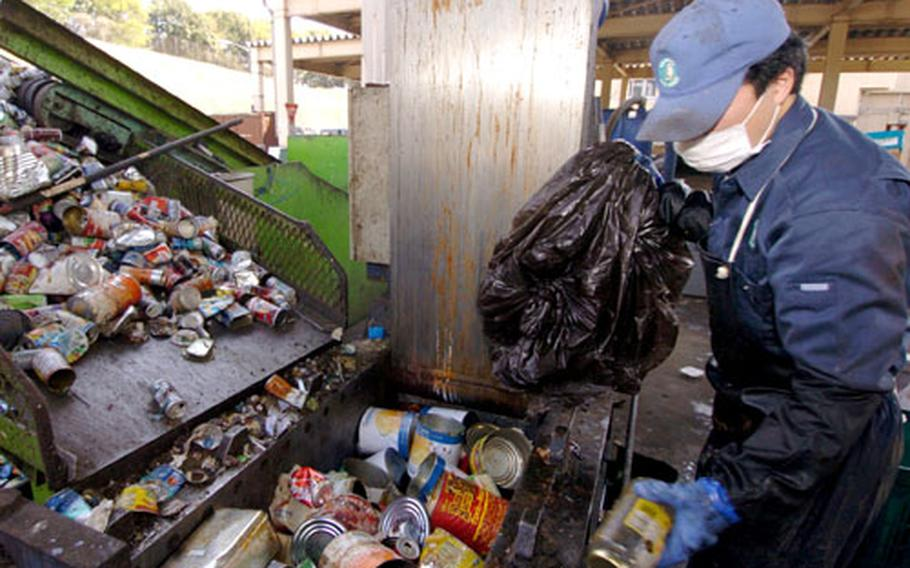 A Japanese worker separates garbage at the Recycling and Incinerator Plant on Yokota Air Base, Japan.