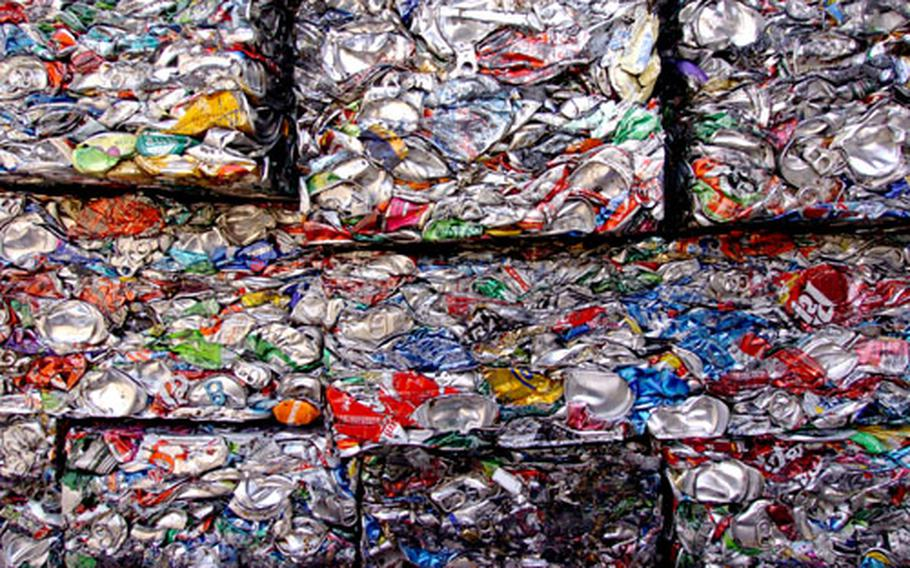 Aluminum and metal cans are crushed into cubes at the Recycling and Incinerator Plant on Yokota Air Base, Japan. In 2005, the facility handled more than 9,000 tons of waste generated by base servicemembers, civilians and their families.