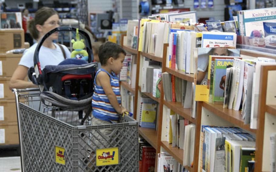 Shoppers look for books in their new location at the main exchange on Camp Foster, Okinawa. The books used to be housed in a separate store called the Bookmark but were moved over the summer.