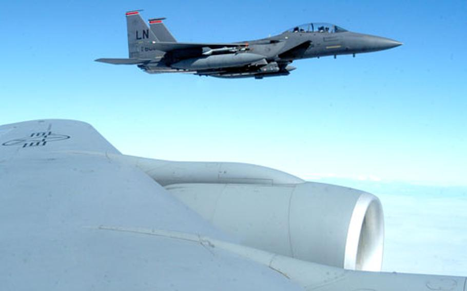 After being refueled, the RAF Lakenheath-based jet fighter hovers next to the wing of the Stratotanker.