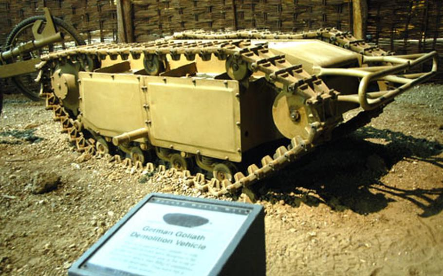 """Exhibits in the hall include hundreds of implements of ground combat used in almost a century of warfare, including oddities such as the German """"Goliath"""" vehicle. It was to be remotely-controlled to creep up next to a pillbox or under a tank and then be detonated."""