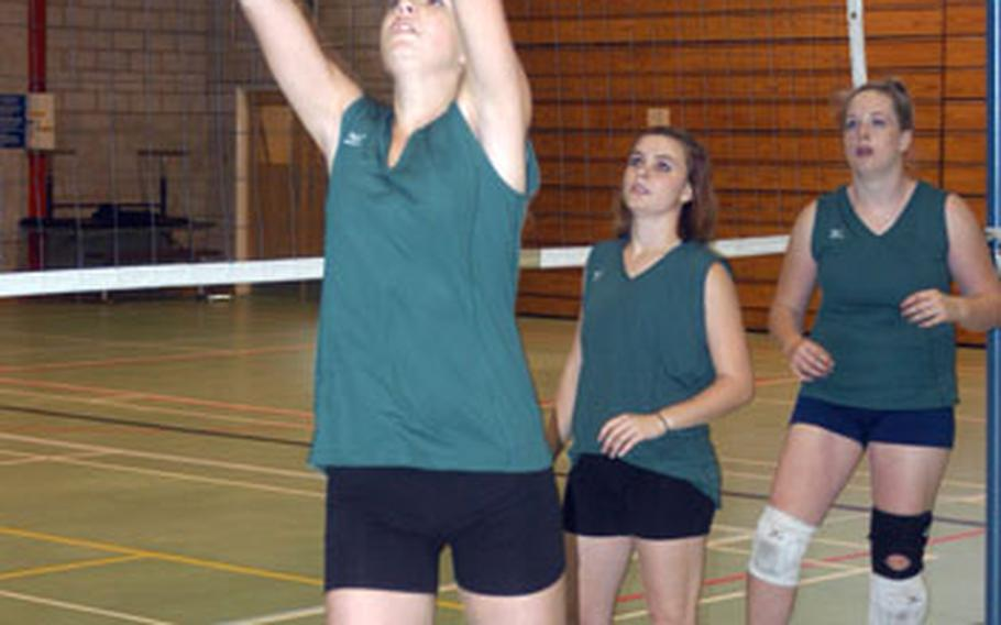 Alconbury sophomore Nikki Reuning conducts a setting drill as senior Brianna Smith and sophomore Caiti Stewart watch during an Alconbury practice last week.