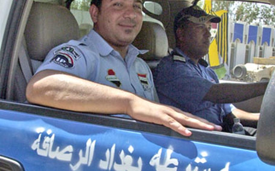 An Iraqi policeman beams from the passenger seat of a new Chevy armored police pickup. American trainers say such vehicles — a huge improvement over what the police were driving before — help build police morale and pride. But they also need basics, such as ammunition, which is difficult to procure from the Iraqi government.