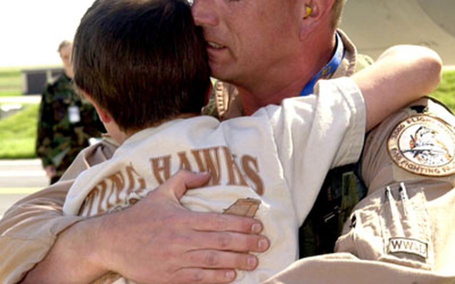 Lt. Col. William Woodcock hugs his son Jacob, 10, after the 23rd Fighter Squadron commander returned home to Spangdahlem Air Base, Germany, on Monday.