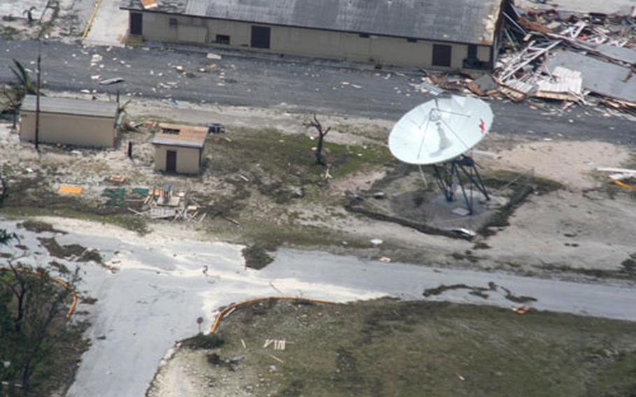 A photo taken over Wake Island during an aerial assessment by the Coast Guard shows buildings damaged by Typhoon Ioke. The overall toll of the storm was not as great as had been feared.